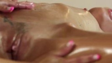 Brunette fucked by couple of masseurs on table